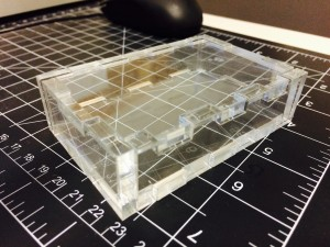 Laser cut box made out of quarter-inch acrylic using a design generated by http://boxmaker.rahulbotics.com
