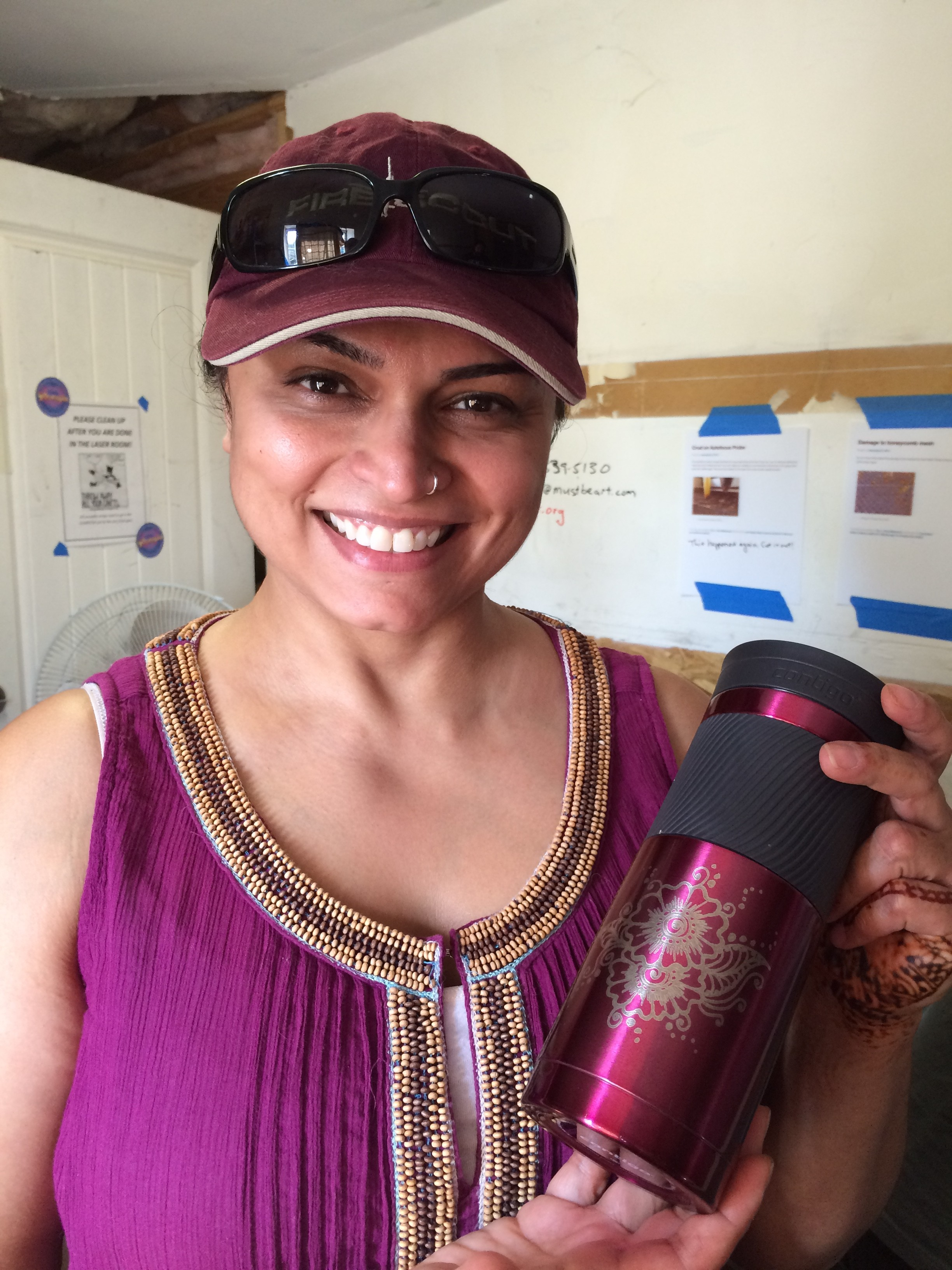 Sonie showing off her anodized aluminum water bottle with the henna pattern freshly engraved on the rotary adapter.