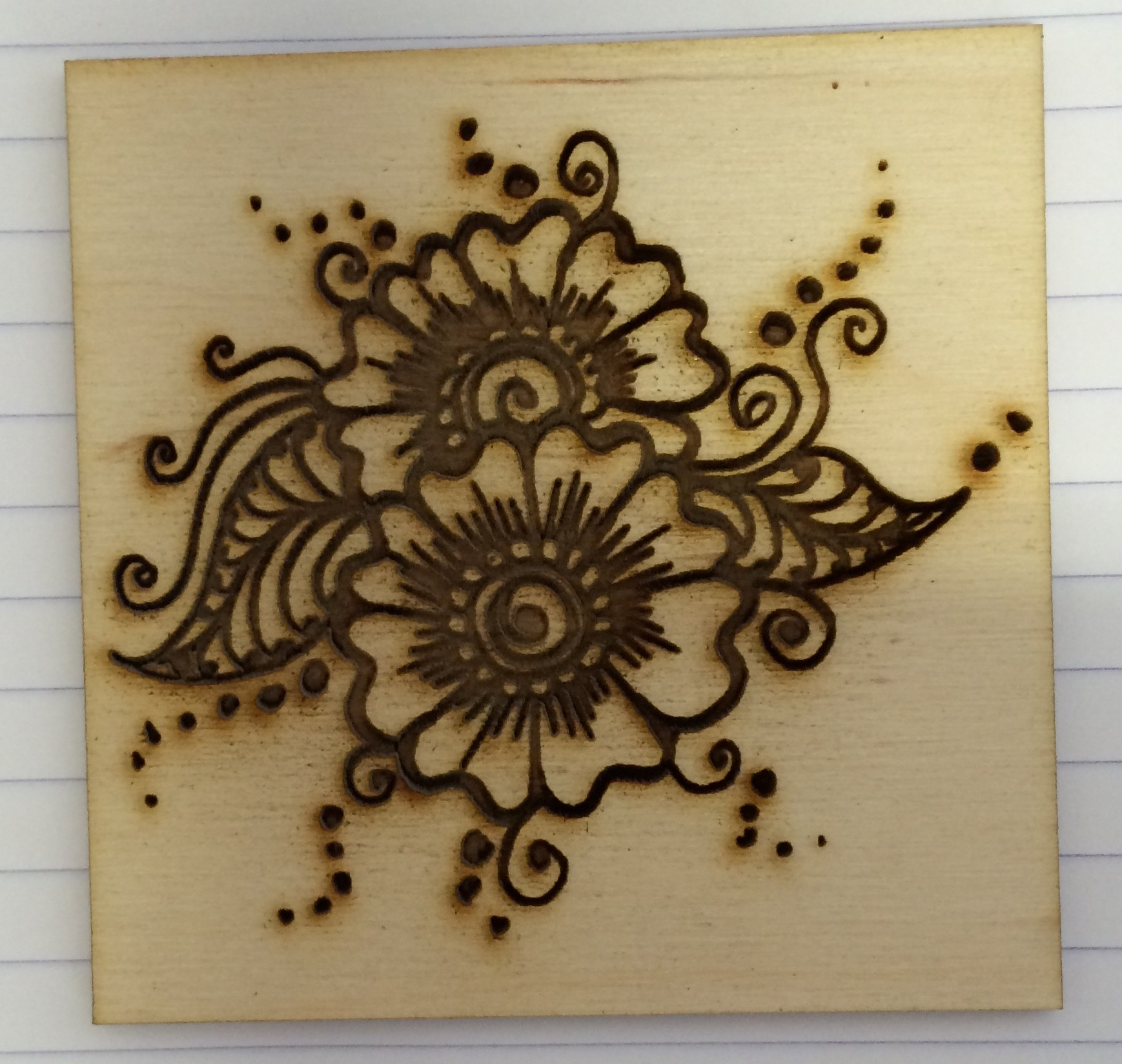 Henna pattern engraved on plywood